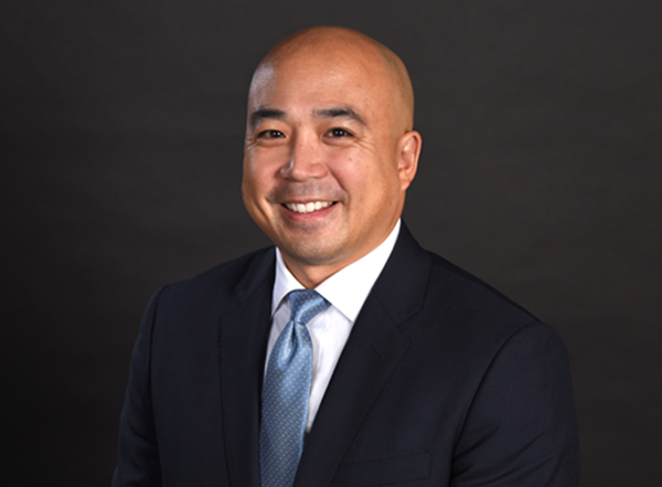 A professional photo of tony lu, director of Pro bono, black background