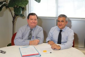 Picture of Volunteer Robert Unetic with CLS SoCal directing attorney Renato Izquieta sitting at a table.