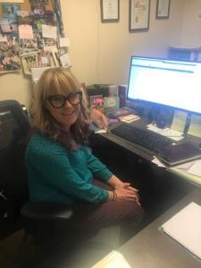 Executive Director Kate Marr at desk